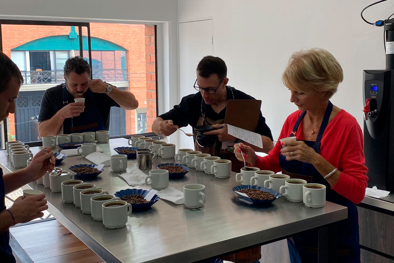 GCC's Quality Control and sales teams cupping new coffees in the Medellin laboratory.